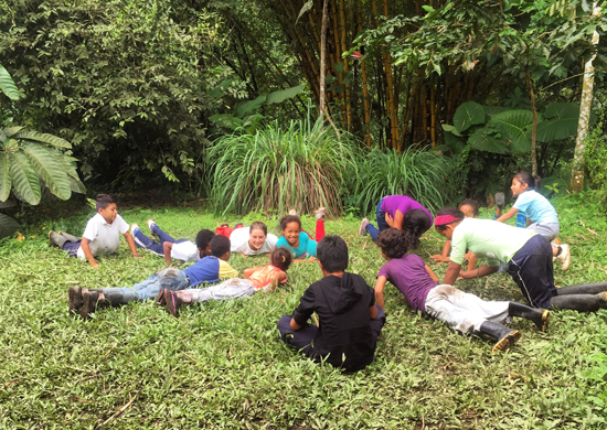 Chelsea teaches youth in Ecuador about metamorphosis through yoga